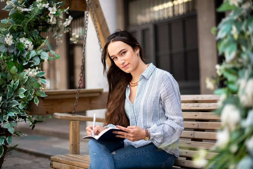 dating photo london. Girl is writing journal in london setting